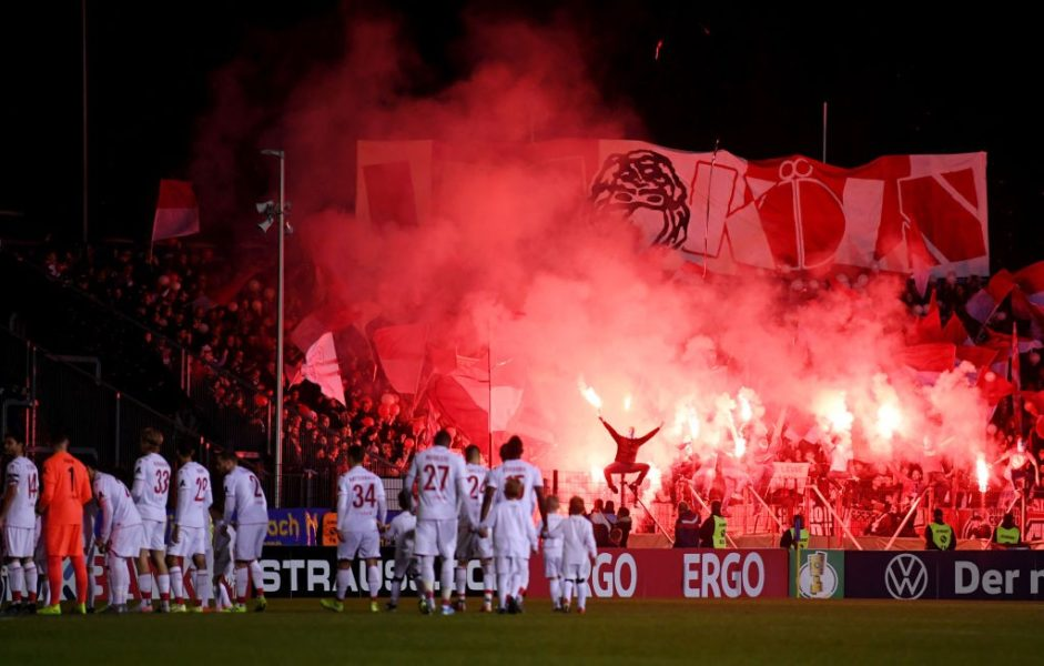 SAARBRUECKEN, GERMANY - OCTOBER 29: Fans let off flares as the FC Koeln team walk out prior to the DFB Cup second round match between 1. FC Saarbruecken and 1. FC Koeln at Ludwigspark Stadion on October 29, 2019 in Saarbruecken, Germany. (Photo by Alex Grimm/Bongarts/Getty Images)