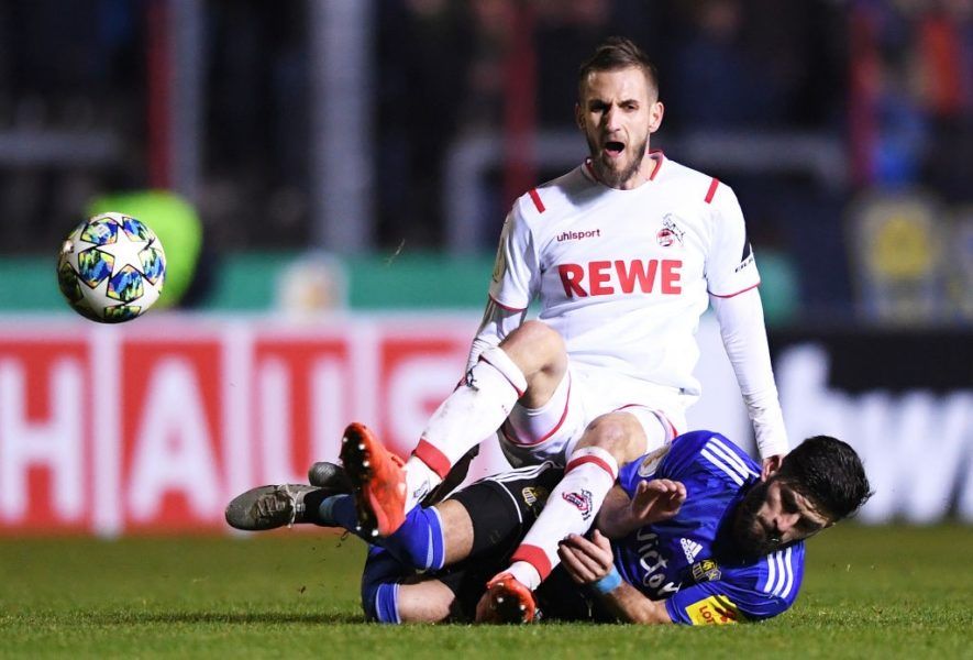 SAARBRUECKEN, GERMANY - OCTOBER 29: Dominick Drexler of 1. FC Koeln is challenged by Fanol Perdedaj of 1 FC. Saarbruecken during the DFB Cup second round match between 1. FC Saarbruecken and 1. FC Koeln at Ludwigspark Stadion on October 29, 2019 in Saarbruecken, Germany. (Photo by Alex Grimm/Bongarts/Getty Images)