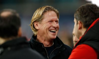 Cologne's German coach Markus Gisdol (C) laughs prior to the German first division Bundesliga football match RB Leipzig v FC Cologne in Leipzig, eastern Germany, on November 23, 2019. (Photo by Odd Andersen / AFP) / RESTRICTIONS: DFL REGULATIONS PROHIBIT ANY USE OF PHOTOGRAPHS AS IMAGE SEQUENCES AND/OR QUASI-VIDEO (Photo by ODD ANDERSEN/AFP via Getty Images)