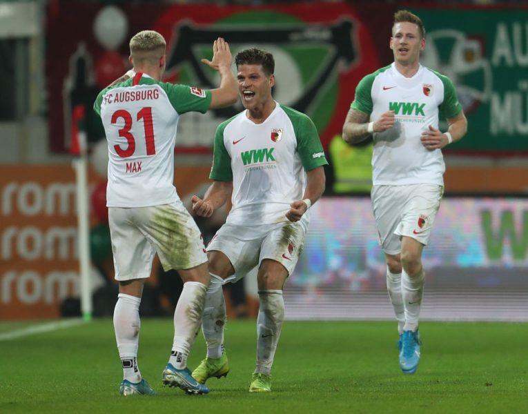 AUGSBURG, GERMANY - NOVEMBER 24: Florian Niederlechner (C) of FC Augsburg celebrates his goal with teammates Philipp Max (L) and Andre Hahn during the Bundesliga match between FC Augsburg and Hertha BSC at WWK-Arena on November 24, 2019 in Augsburg, Germany. (Photo by Alexandra Beier/Bongarts/Getty Images)
