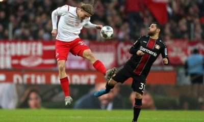 COLOGNE, GERMANY - DECEMBER 14: Sebastiaan Bornauw of 1. FC Koeln jumps for the ball against Kevin Volland of Bayer 04 Leverkusen during the Bundesliga match between 1. FC Koeln and Bayer 04 Leverkusen at RheinEnergieStadion on December 14, 2019 in Cologne, Germany. (Photo by Lars Baron/Bongarts/Getty Images)