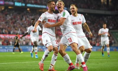 COLOGNE, GERMANY - AUGUST 23: Dominick Drexler of 1. FC Koeln (L) celebrates with his team mates after scoring his side's first goal during the Bundesliga match between 1. FC Koeln and Borussia Dortmund at RheinEnergieStadion on August 23, 2019 in Cologne, Germany. (Photo by Matthias Hangst/Bongarts/Getty Images)