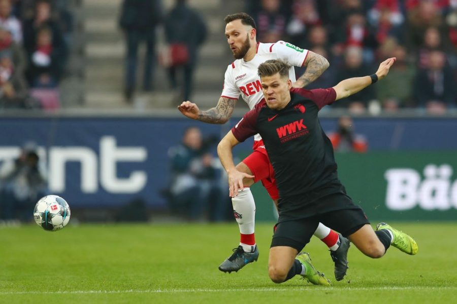 COLOGNE, GERMANY - NOVEMBER 30: Marco Hoger of 1. FC Koeln battles for possession with Florian Niederlechner of FC Augsburg during the Bundesliga match between 1. FC Koeln and FC Augsburg at RheinEnergieStadion on November 30, 2019 in Cologne, Germany. (Photo by Lars Baron/Bongarts/Getty Images)