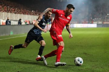 BERLIN, GERMANY - DECEMBER 08: Dominick Drexler of 1. FC Koeln battles for possession with Christopher Trimmel of 1. FC Union Berlin during the Bundesliga match between 1. FC Union Berlin and 1. FC Koeln at Stadion An der Alten Foersterei on December 08, 2019 in Berlin, Germany. (Photo by Maja Hitij/Bongarts/Getty Images)