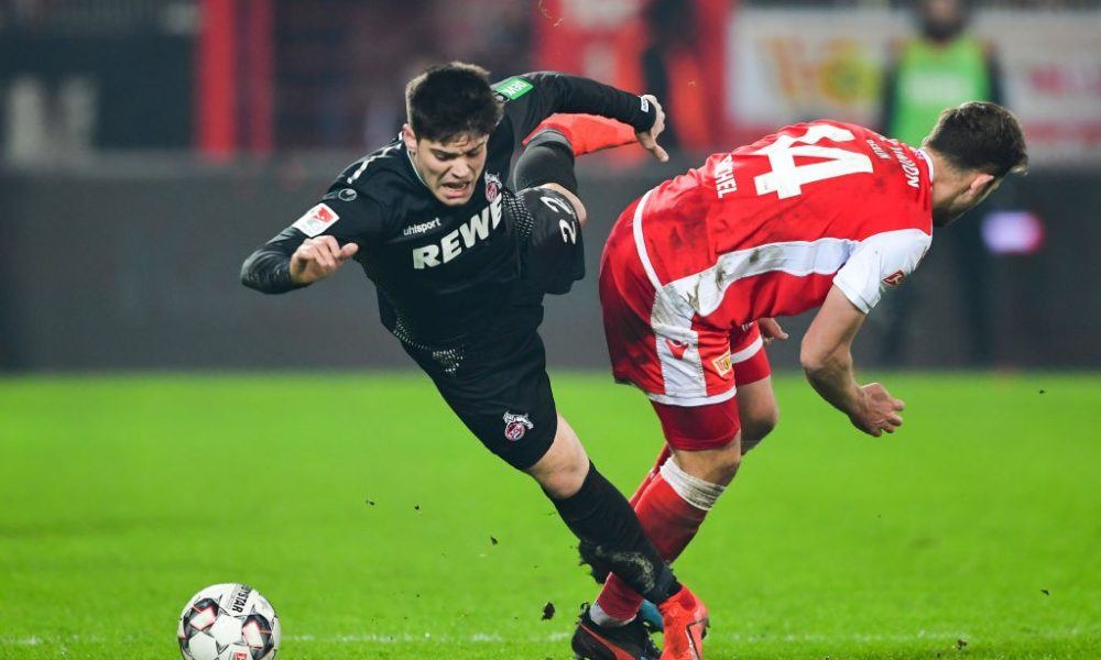 BERLIN, GERMANY - JANUARY 31: Jorge Mere of Koeln is challenged by Ken Reichel of Berlin during the Second Bundesliga match between 1. FC Union Berlin and 1. FC Koeln at Stadion An der Alten Foersterei on January 31, 2019 in Berlin, Germany. (Photo by Stuart Franklin/Bongarts/Getty Images)
