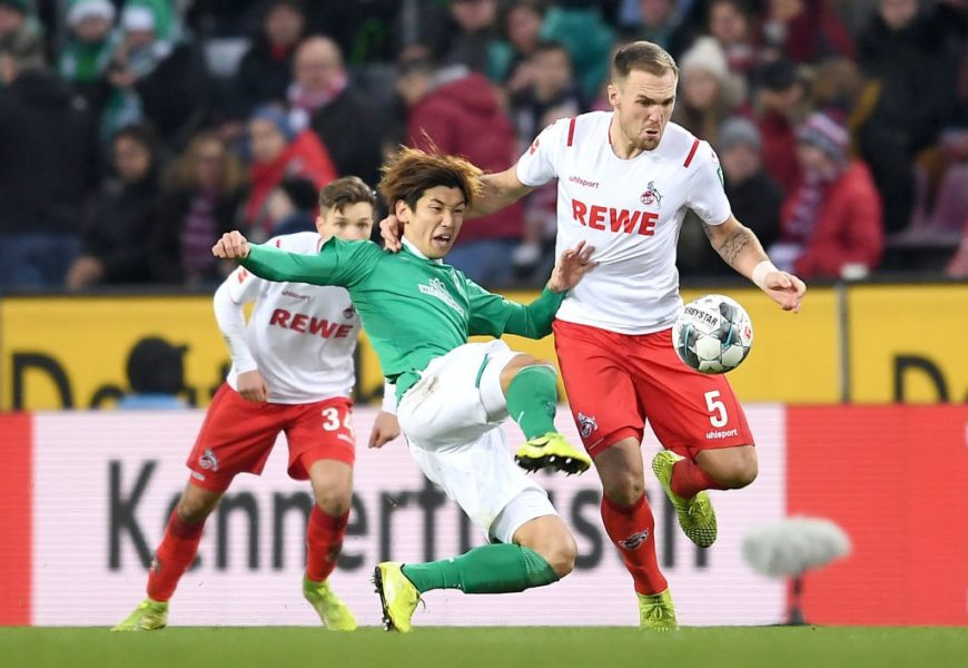 COLOGNE, GERMANY - DECEMBER 21: Yuya Osako of SV Werder Bremen tackles Rafael Czichos of 1. FC Koeln during the Bundesliga match between 1. FC Koeln and SV Werder Bremen at RheinEnergieStadion on December 21, 2019 in Cologne, Germany. (Photo by Jörg Schüler/Bongarts/Getty Images)