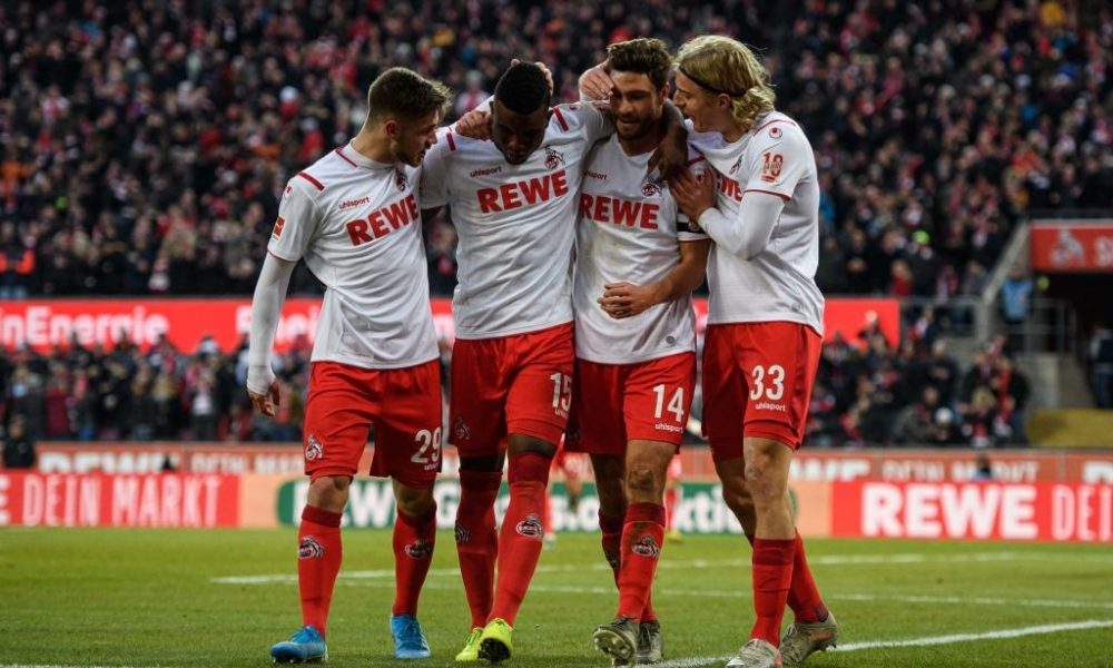 COLOGNE, GERMANY - JANUARY 18: L-R Jan Thielmann, Jhon Cordoba, Jonas Hector and Sebastian Bornauw of Cologne celebrate after their teams third goal during the Bundesliga match between 1. FC Koeln and VfL Wolfsburg at RheinEnergieStadion on January 18, 2020 in Cologne, Germany. (Photo by Jörg Schüler/Bongarts/Getty Images)