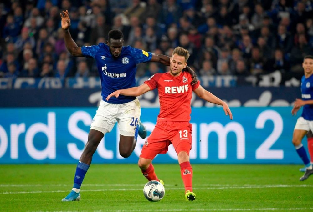 Schalke's German midfielder Suat Serdar (L) and Cologne's Austrian midfielder Louis Schaub vie for the ball during the German first division Bundesliga football match FC Schalke 04 vs FC Cologne in Gelsenkirchen, western Germany, on October 5, 2019. (Photo by INA FASSBENDER / AFP) / DFL REGULATIONS PROHIBIT ANY USE OF PHOTOGRAPHS AS IMAGE SEQUENCES AND/OR QUASI-VIDEO (Photo by INA FASSBENDER/AFP via Getty Images)