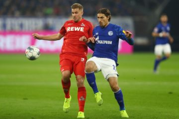 GELSENKIRCHEN, GERMANY - OCTOBER 05: Benjamin Stambouli of FC Schalke 04 is challenged by Simon Terodde of 1. FC Koln during the Bundesliga match between FC Schalke 04 and 1. FC Koeln at Veltins-Arena on October 05, 2019 in Gelsenkirchen, Germany. (Photo by Dean Mouhtaropoulos/Bongarts/Getty Images)