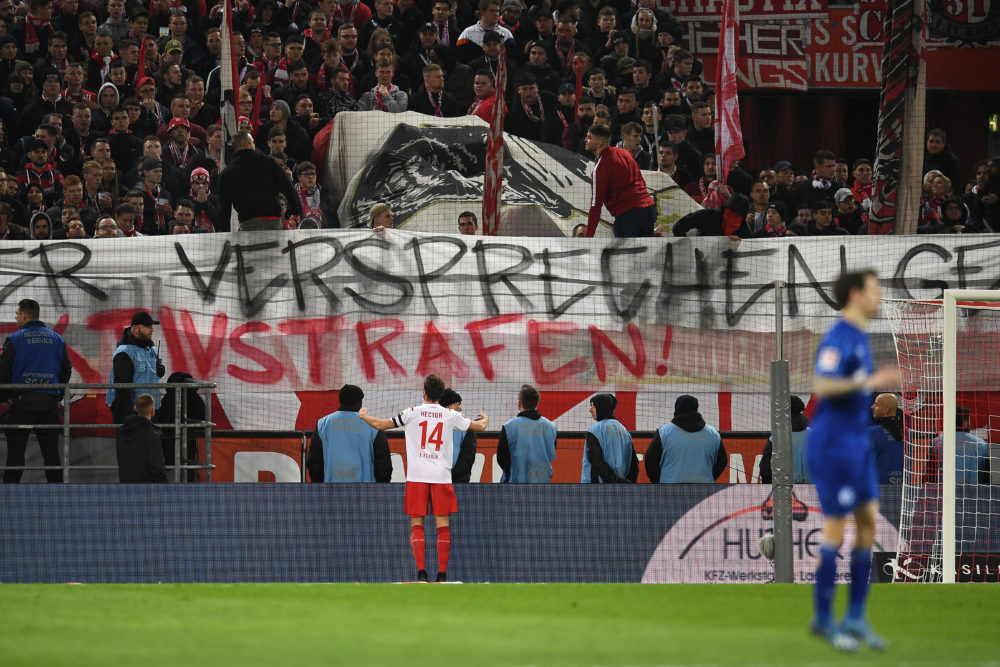 COLOGNE, GERMANY - FEBRUARY 29: Jonas Hector of 1. FC Koeln reasons with fans as they display a banner during the Bundesliga match between 1. FC Koeln and FC Schalke 04 at RheinEnergieStadion on February 29, 2020 in Cologne, Germany. (Photo by Jörg Schüler/Bongarts/Getty Images)