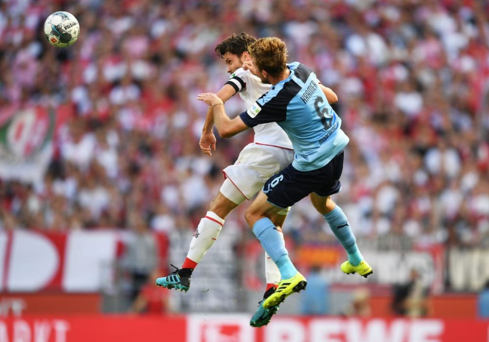COLOGNE, GERMANY - SEPTEMBER 14: Jonas Hector of 1. FC Koln and Christoph Kramer of Borussia Monchengladbach jump for the ball during the Bundesliga match between 1. FC Koeln and Borussia Moenchengladbach at RheinEnergieStadion on September 14, 2019 in Cologne, Germany. (Photo by Jörg Schüler/Bongarts/Getty Images)