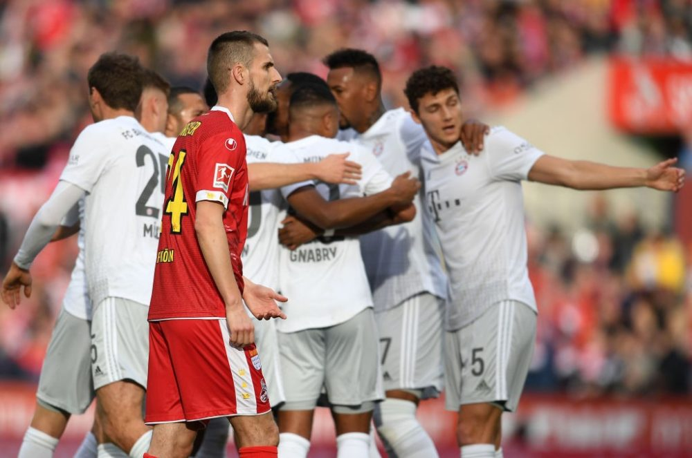 COLOGNE, GERMANY - FEBRUARY 16: Dominick Drexler of FC Koln cuts a dejected figure as Serge Gnabry of FC Bayern Muenchen celebrates after scoring his sides third goal during the Bundesliga match between 1. FC Koeln and FC Bayern Muenchen at RheinEnergieStadion on February 16, 2020 in Cologne, Germany. (Photo by Jörg Schüler/Bongarts/Getty Images)