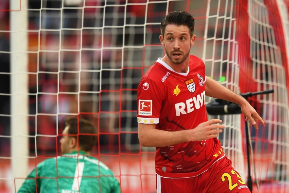COLOGNE, GERMANY - FEBRUARY 16: Mark Uth of FC Koln celebrates after scoring his sides first goal during the Bundesliga match between 1. FC Koeln and FC Bayern Muenchen at RheinEnergieStadion on February 16, 2020 in Cologne, Germany. (Photo by Jörg Schüler/Bongarts/Getty Images)
