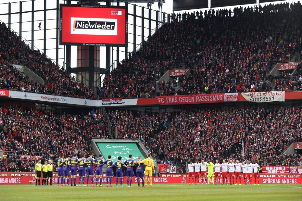 COLOGNE, GERMANY - FEBRUARY 02: The players observe a minutes silence ahead of kick-off in remembrance of the victims of the Holocaust during the Bundesliga match between 1. FC Koeln and Sport-Club Freiburg at RheinEnergieStadion on February 02, 2020 in Cologne, Germany. (Photo by Lars Baron/Bongarts/Getty Images)