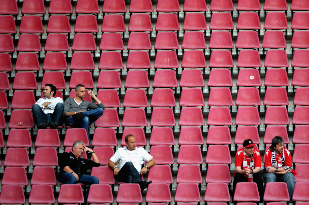 COLOGNE, GERMANY - AUGUST 10: Spectators watch the Second Bundesliga match between 1. FC Koeln and SV Sandhausen at RheinEnergieStadion on August 10, 2012 in Cologne, Germany. (Photo by Dennis Grombkowski/Bongarts/Getty Images)
