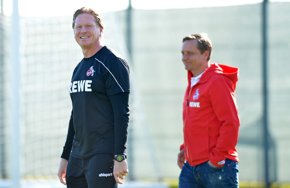 BENIDORM, SPAIN - JANUARY 08: (BILD ZEITUNG OUT) head coach Markus Gisdol of 1. FC Koeln and CEO Sport Horst Heldt of 1. FC Koeln laughs during the 1. FC Koeln winter training camp on January 8, 2020 in Benidorm, Spain. (Photo by TF-Images/Getty Images)