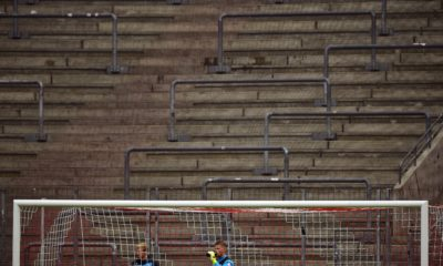 Cologne's goalkeeper Timo Horn is pictured in front of an empty stand during the German first division Bundesliga football match between 1 FC Cologne and Bayer 04 Leverkusen in Cologne, western Germany, on April 25, 2015. AFP PHOTO / SASCHA SCHUERMANN RESTRICTIONS - DFL RULES TO LIMIT THE ONLINE USAGE DURING MATCH TIME TO 15 PICTURES PER MATCH. IMAGE SEQUENCES TO SIMULATE VIDEO IS NOT ALLOWED AT ANY TIME. FOR FURTHER QUERIES PLEASE CONTACT DFL DIRECTLY AT + 49 69 650050. (Photo credit should read SASCHA SCHUERMANN/AFP via Getty Images)