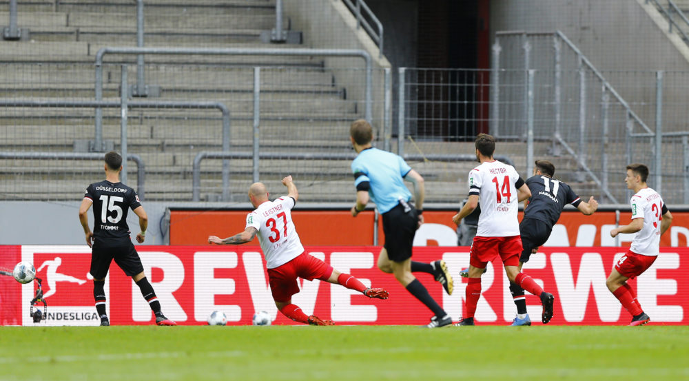 COLOGNE, GERMANY - MAY 24: Kenan Karaman of Fortuna Dusseldorf scores their first goal during the Bundesliga match between 1. FC Koeln and Fortuna Duesseldorf at RheinEnergieStadion on May 24, 2020 in Cologne, Germany. (Photo by Pool/Thilo Schmuelgen/Pool via Getty Images)