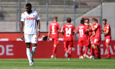 COLOGNE, GERMANY - JUNE 13: Anthony Modeste of 1. FC Koeln reacts as Christian Gentner of 1.FC Union Berlin (background) celebrates with his team mates after scoring his team's second goal during the Bundesliga match between 1. FC Koeln and 1. FC Union Berlin at RheinEnergieStadion on June 13, 2020 in Cologne, Germany. (Photo by Alexander Scheuber/Getty Images)