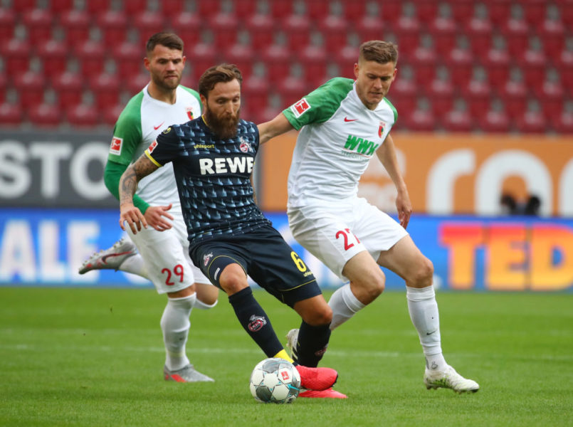 Augsburg's Icelandic forward Alfred Finnbogason (R) and Cologne's German midfielder Marco Hoeger vie for the ball during the German first division Bundesliga football match FC Augsburg v 1. FC Cologne on June 7, 2020 in Augsburg, southern Germany. (Photo by Michael DALDER / POOL / AFP) / DFL REGULATIONS PROHIBIT ANY USE OF PHOTOGRAPHS AS IMAGE SEQUENCES AND/OR QUASI-VIDEO (Photo by MICHAEL DALDER/POOL/AFP via Getty Images)