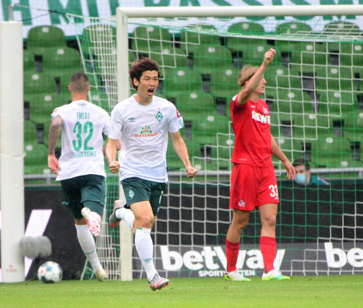 Bremen's Japanese forward Yuya Osako celebrates scoring the 1-0 during the German first division Bundesliga football match Werder Bremen v FC Cologne on June 27, 2020 in Bremen. (Photo by Patrik Stollarz / various sources / AFP) / DFL REGULATIONS PROHIBIT ANY USE OF PHOTOGRAPHS AS IMAGE SEQUENCES AND/OR QUASI-VIDEO (Photo by PATRIK STOLLARZ/AFP via Getty Images)