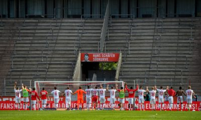 Cologne's players greet the absent fans in front of empty stands after the German first division Bundesliga football match FC Cologne v Eintracht Frankfurt on June 20, 2020 in Cologne, western Germany. (Photo by SASCHA SCHUERMANN / various sources / AFP) / DFL REGULATIONS PROHIBIT ANY USE OF PHOTOGRAPHS AS IMAGE SEQUENCES AND/OR QUASI-VIDEO (Photo by SASCHA SCHUERMANN/AFP via Getty Images)