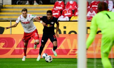 Cologne's German defender Benno Schmitz (L) and Leipzig's French midfielder Christopher Nkunku (R) vie for the ball during the German first division Bundesliga football match FC Cologne vs RB Leipzig, in Cologne on June 1, 2020. (Photo by Ina FASSBENDER / various sources / AFP) / DFL REGULATIONS PROHIBIT ANY USE OF PHOTOGRAPHS AS IMAGE SEQUENCES AND/OR QUASI-VIDEO (Photo by INA FASSBENDER/AFP via Getty Images)