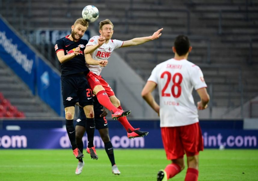 Leipzig's Austrian midfielder Konrad Laimer (L) and Cologne's Austrian midfielder Florian Kainz vie for the ball during the German first division Bundesliga football match FC Cologne vs RB Leipzig, in Cologne on June 1, 2020. (Photo by Ina FASSBENDER / various sources / AFP) / DFL REGULATIONS PROHIBIT ANY USE OF PHOTOGRAPHS AS IMAGE SEQUENCES AND/OR QUASI-VIDEO (Photo by INA FASSBENDER/AFP via Getty Images)
