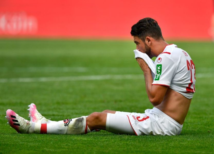 Cologne's German forward Mark Uth reacts on the pitch after the German first division Bundesliga football match FC Cologne v FC Union Berlin on June 13, 2020 in Cologne, western Germany. (Photo by Martin Meissner / POOL / AFP) / DFL REGULATIONS PROHIBIT ANY USE OF PHOTOGRAPHS AS IMAGE SEQUENCES AND/OR QUASI-VIDEO (Photo by MARTIN MEISSNER/POOL/AFP via Getty Images)v