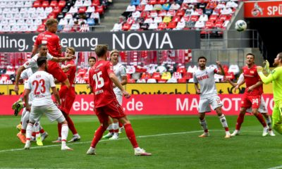 Union's Marvin Friedrich (topL) scores the opening goal during the German first division Bundesliga football match FC Cologne v FC Union Berlin on June 13, 2020 in Cologne, western Germany. (Photo by Martin Meissner / POOL / AFP) / DFL REGULATIONS PROHIBIT ANY USE OF PHOTOGRAPHS AS IMAGE SEQUENCES AND/OR QUASI-VIDEO (Photo by MARTIN MEISSNER/POOL/AFP via Getty Images)