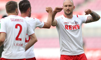 COLOGNE, GERMANY - MAY 17: Toni Leistner (R) of 1. FC Koeln celebrates with Mark Uth of 1. FC Koeln during the Bundesliga match between 1. FC Koeln and 1. FSV Mainz 05 at RheinEnergieStadion on May 17, 2020 in Cologne, Germany. The Bundesliga and Second Bundesliga is the first professional league to resume the season after the nationwide lockdown due to the ongoing Coronavirus (COVID-19) pandemic. All matches until the end of the season will be played behind closed doors. (Photo by Lars Baron/Getty Images)