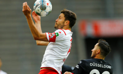 Cologne's German defender Jonas Hector (L) and Fortuna Duesseldorf's German forward Steven Skrzybski vie for the ball during the German first division Bundesliga football match FC Cologne v Fortuna Dusseldorf on May 24, 2020 in Cologne, western Germany. (Photo by Thilo SCHMUELGEN / POOL / AFP) / DFL REGULATIONS PROHIBIT ANY USE OF PHOTOGRAPHS AS IMAGE SEQUENCES AND/OR QUASI-VIDEO (Photo by THILO SCHMUELGEN/POOL/AFP via Getty Images)