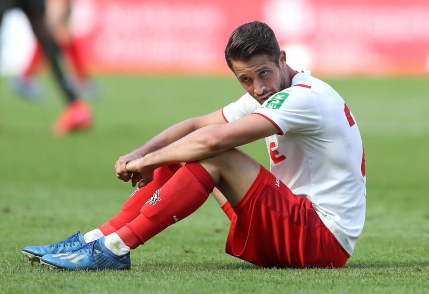 Cologne's German forward Mark Uth reacts after the German first division Bundesliga football match FC Cologne v Mainz 05 on May 17, 2020 in Cologne, western Germany as the season resumed following a two-month absence due to the novel coronavirus COVID-19 pandemic. (Photo by Lars Baron / POOL / AFP) / DFL REGULATIONS PROHIBIT ANY USE OF PHOTOGRAPHS AS IMAGE SEQUENCES AND/OR QUASI-VIDEO (Photo by LARS BARON/POOL/AFP via Getty Images)