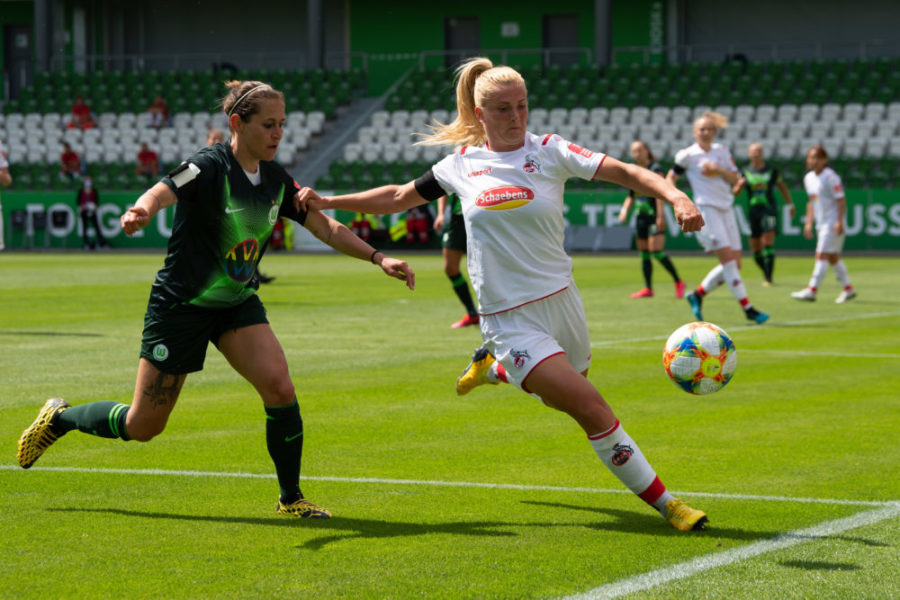 WOLFSBURG, GERMANY - MAY 29: Cologne's Rachel Rinast (r) plays against Wolfsburg's Anna Blässe during the Flyeralarm Frauen Bundesliga match between VfL Wolfsburg Women's and 1. FC Koeln Women's at AOK Stadion on May 29, 2020 in Wolfsburg, Germany. (Photo by Sven Pfoertner/Pool via Getty Images )