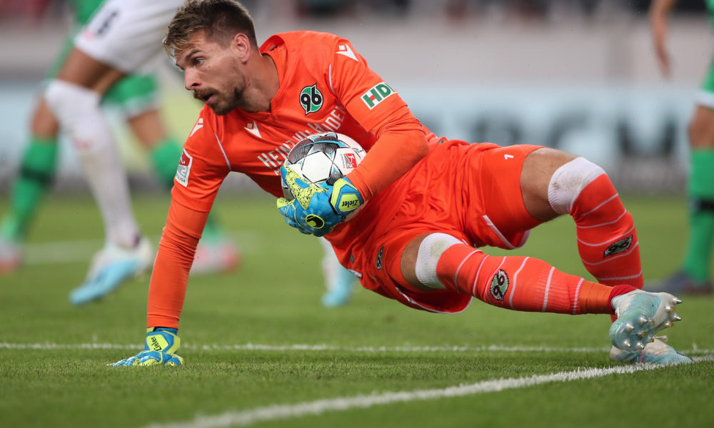 STUTTGART, GERMANY - JULY 26: Ron-Robert Zieler of Hannover 96 holds the ball during the Second Bundesliga match between VfB Stuttgart and Hannover 96 at Mercedes-Benz Arena on July 26, 2019 in Stuttgart, Germany. (Photo by Christian Kaspar-Bartke/Bongarts/Getty Images)