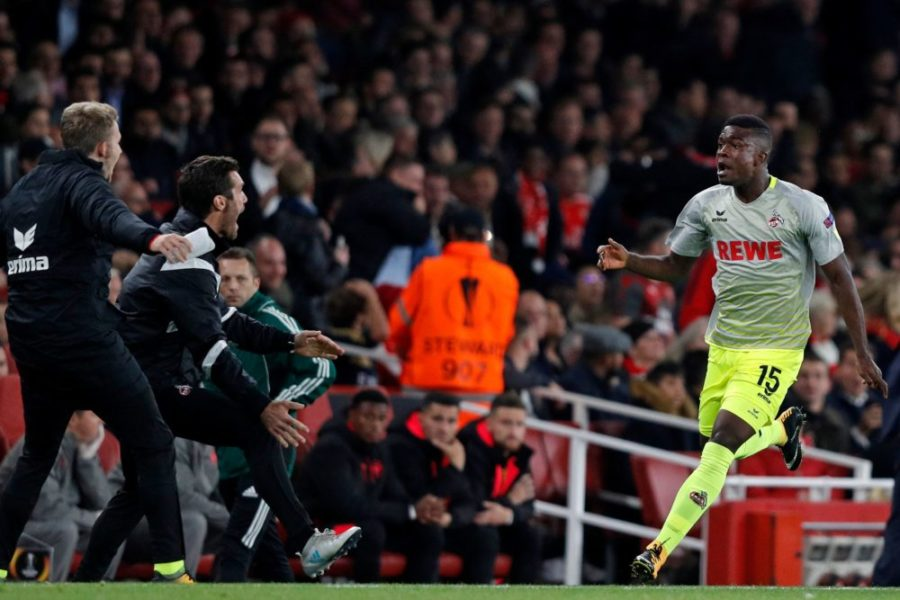 FC Cologne's Colombian striker Jhon Andres Cordoba Copete (R) celebrates after scoring his long-range opening goal during the UEFA Europa League Group H football match between Arsenal and FC Cologne at The Emirates Stadium in London on September 14, 2017. / AFP PHOTO / Adrian DENNIS (Photo credit should read ADRIAN DENNIS/AFP via Getty Images)