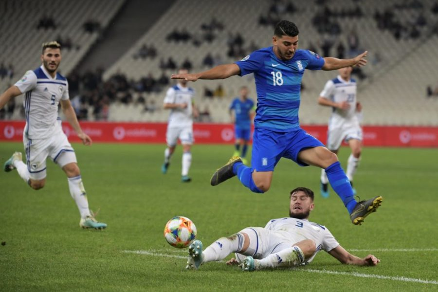 Bosnia's Ermin Bicakcic vies with Greece's Dimitris Limnios (up) during the Euro 2020 Group J qualification football match between Greece and Bosnia-Herzegovina at the OACA Spyros Louis stadium in Athens on October 15, 2019. (Photo by ARIS MESSINIS / AFP) (Photo by ARIS MESSINIS/AFP via Getty Images)