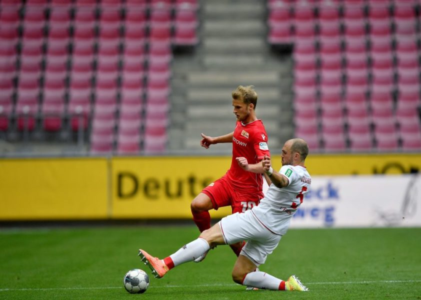 Union's Sebastian Andersson (L) vies with Cologne's Rafael Czichos during the German first division Bundesliga football match FC Cologne v FC Union Berlin on June 13, 2020 in Cologne, western Germany. (Photo by Martin Meissner / POOL / AFP) / DFL REGULATIONS PROHIBIT ANY USE OF PHOTOGRAPHS AS IMAGE SEQUENCES AND/OR QUASI-VIDEO (Photo by MARTIN MEISSNER/POOL/AFP via Getty Images)