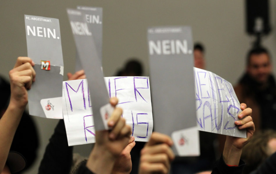 COLOGNE, GERMANY - NOVEMBER 17: Members of 1. FC Koeln hold voting letters in the air during the general meeting of 1. FC Koeln at the StaatenHaus on November 17, 2010 in Cologne, Germany. (Photo by Lars Baron/Bongarts/Getty Images)