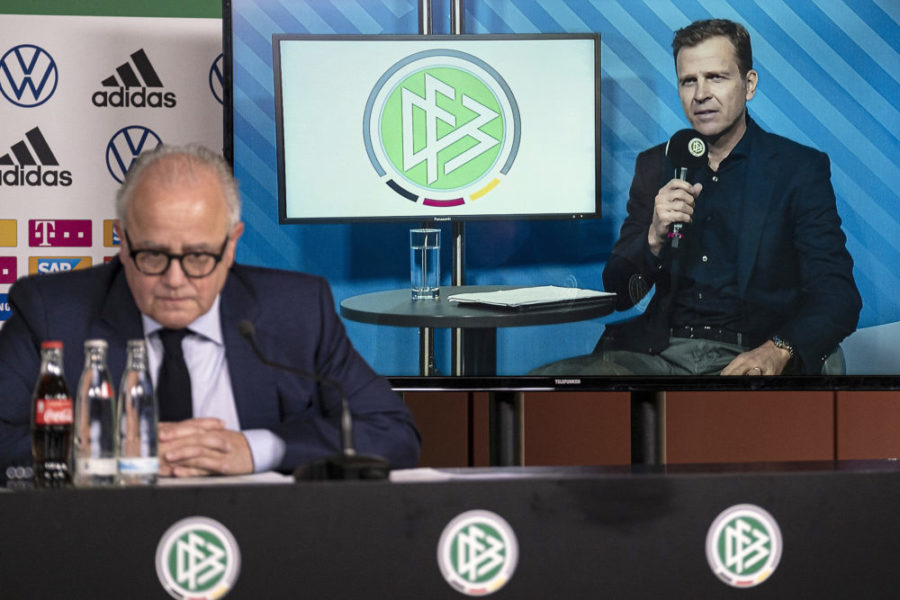 FRANKFURT AM MAIN, GERMANY - MARCH 18: DFB director for national teams and the DFB academy Oliver Bierhoff (cut in) talks to the media whilst DFB president Fritz Keller (L) looks on during a video press conference at DFB Headquarter on March 18, 2020 in Frankfurt am Main, Germany. (Photo by Thomas Boecker/DFB/Pool/Getty Images)