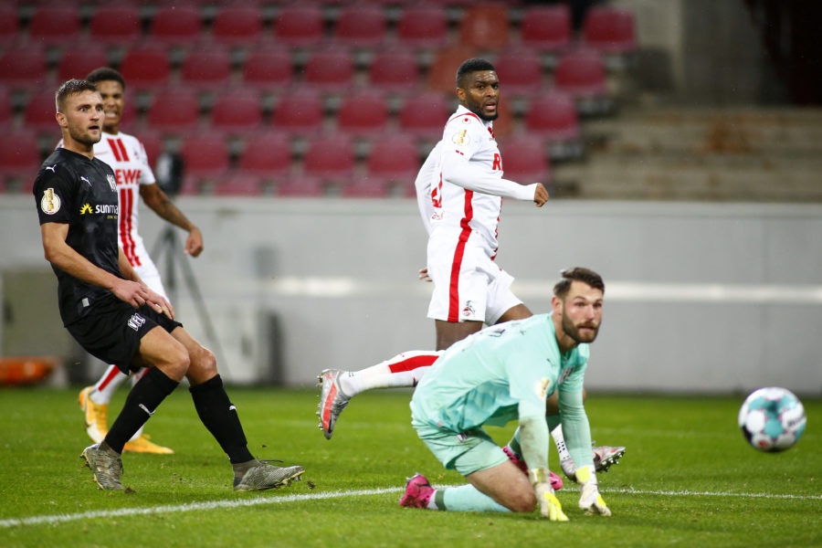 COLOGNE, GERMANY - DECEMBER 22: Anthony Modeste of 1.FC Koeln scores their team's first goal during the DFB Cup second round match between 1. FC Koeln and VfL Osnabrueck at RheinEnergieStadion on December 22, 2020 in Cologne, Germany. Sporting stadiums around Germany remain under strict restrictions due to the Coronavirus Pandemic as Government social distancing laws prohibit fans inside venues resulting in games being played behind closed doors. (Photo by Thilo Schmuelgen - Pool/Getty Images)