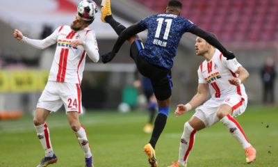 COLOGNE, GERMANY - JANUARY 16: Dominick Drexler of 1. FC Koln is challenged by Dodi Lukebakio of Hertha BSC during the Bundesliga match between 1. FC Koeln and Hertha BSC at RheinEnergieStadion on January 16, 2021 in Cologne, Germany. Sporting stadiums around Germany remain under strict restrictions due to the Coronavirus Pandemic as Government social distancing laws prohibit fans inside venues resulting in games being played behind closed doors. (Photo by Lars Baron/Getty Images)