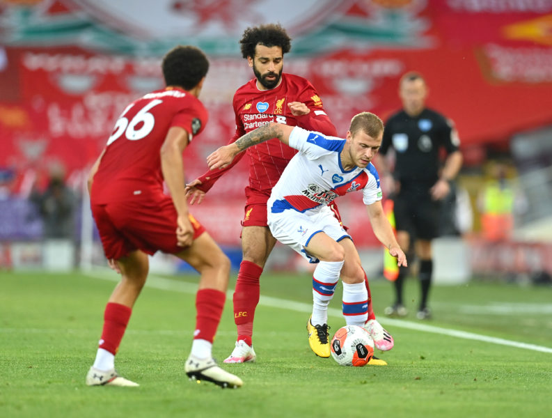 LIVERPOOL, ENGLAND - JUNE 24: Mohamed Salah of Liverpool battles for possession with Max Meyer of Crystal Palace during the Premier League match between Liverpool FC and Crystal Palace at Anfield on June 24, 2020 in Liverpool, England. (Photo by Paul Ellis/Pool via Getty Images)