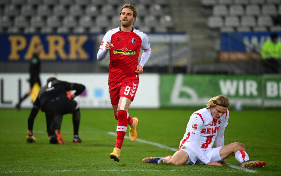FREIBURG IM BREISGAU, GERMANY - JANUARY 09: Lucas Holer of Sport-Club Freiburg celebrates after scoring his team's fifth goal during the Bundesliga match between Sport-Club Freiburg and 1. FC Koeln at Schwarzwald-Stadion on January 09, 2021 in Freiburg im Breisgau, Germany. Sporting stadiums around Germany remain under strict restrictions due to the Coronavirus Pandemic as Government social distancing laws prohibit fans inside venues resulting in games being played behind closed doors. (Photo by Matthias Hangst/Getty Images)