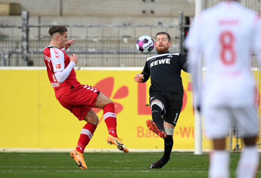 FREIBURG IM BREISGAU, GERMANY - JANUARY 09: Ermedin Demirovic of Sport-Club Freiburg on his way to scoring his team's first goal past Timo Horn of 1. FC Koln during the Bundesliga match between Sport-Club Freiburg and 1. FC Koeln at Schwarzwald-Stadion on January 09, 2021 in Freiburg im Breisgau, Germany. Sporting stadiums around Germany remain under strict restrictions due to the Coronavirus Pandemic as Government social distancing laws prohibit fans inside venues resulting in games being played behind closed doors. (Photo by Matthias Hangst/Getty Images)