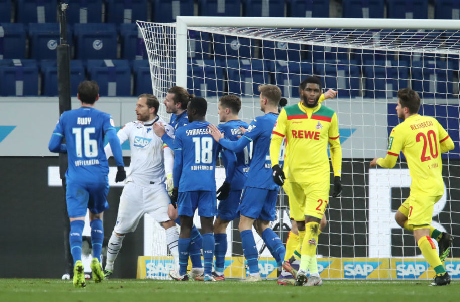 SINSHEIM, GERMANY - JANUARY 24: Anthony Modeste of 1. FC Koln looks dejected after missing a penalty as Oliver Baumann of TSG 1899 Hoffenheim is congratulated by team mates during the Bundesliga match between TSG Hoffenheim and 1. FC Koeln at PreZero-Arena on January 24, 2021 in Sinsheim, Germany. Sporting stadiums around Germany remain under strict restrictions due to the Coronavirus Pandemic as Government social distancing laws prohibit fans inside venues resulting in games being played behind closed doors. (Photo by Alex Grimm/Getty Images)