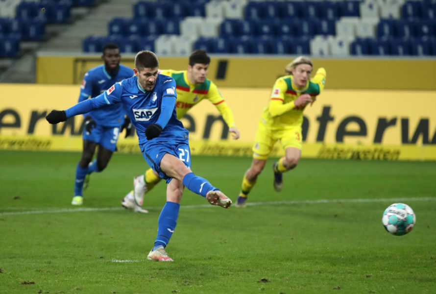 SINSHEIM, GERMANY - JANUARY 24: Andrej Kramaric of TSG 1899 Hoffenheim scores their side's third goal from the penalty spot during the Bundesliga match between TSG Hoffenheim and 1. FC Koeln at PreZero-Arena on January 24, 2021 in Sinsheim, Germany. Sporting stadiums around Germany remain under strict restrictions due to the Coronavirus Pandemic as Government social distancing laws prohibit fans inside venues resulting in games being played behind closed doors. (Photo by Alex Grimm/Getty Images)