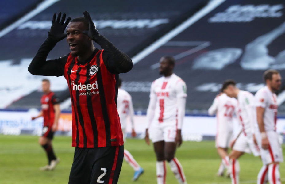 FRANKFURT AM MAIN, GERMANY - FEBRUARY 14: Evan Ndicka of Eintracht Frankfurt celebrates after scoring their side's second goal during the Bundesliga match between Eintracht Frankfurt and 1. FC Koeln at Deutsche Bank Park on February 14, 2021 in Frankfurt am Main, Germany. Sporting stadiums around Germany remain under strict restrictions due to the Coronavirus Pandemic as Government social distancing laws prohibit fans inside venues resulting in games being played behind closed doors. (Photo by Alex Grimm/Getty Images)