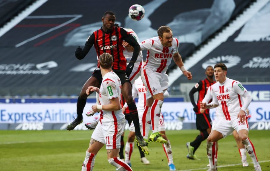 Frankfurt's French defender Evan N'Dicka (L) heads the ball to score his team's second goal during the German first division Bundesliga football match between Eintracht Frankfurt and FC Cologne in Frankfurt am Main, western Germany, on February 14, 2021. (Photo by KAI PFAFFENBACH / POOL / AFP) / DFL REGULATIONS PROHIBIT ANY USE OF PHOTOGRAPHS AS IMAGE SEQUENCES AND/OR QUASI-VIDEO (Photo by KAI PFAFFENBACH/POOL/AFP via Getty Images)